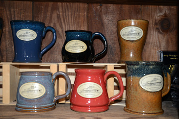 What's better than sitting and reading a book about railroads? Sipping a hot beverage while you do it! Stoneware mugs with an image of the Depot are available in a variety of styles and colors for $23.95. These mugs are made in the USA by Sunset Hills Stoneware.