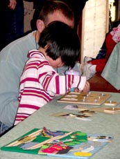 A child works on a puzzle during Spring Pre-School Train 2007